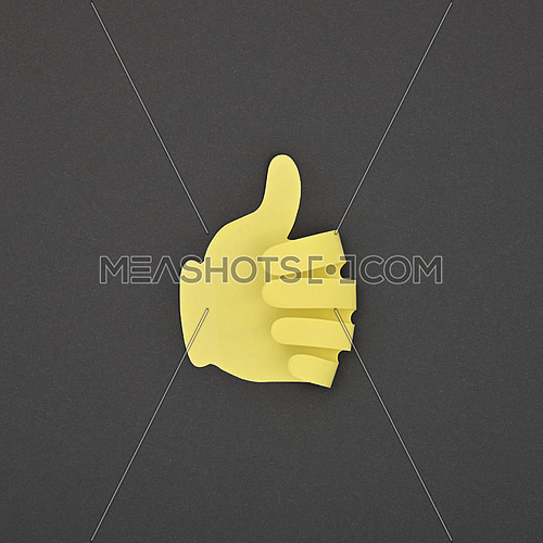 Paper made yellow LIKE hand gesture sticker over grey background
