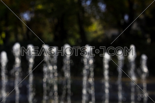 Fountain Splashing Water In The Park Blured and out of Focus for Backround Use
