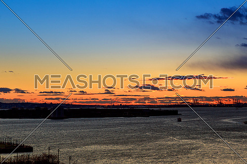 Statue of Liberty at sunset as viewed from Brooklyn, New York