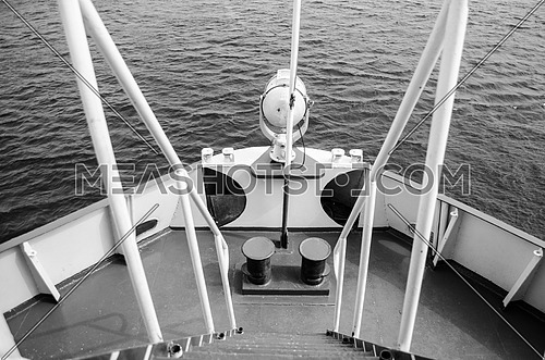 A front deck of a boat in black and white