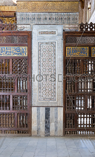 Architectural detail of a decorative mosaic marble colored panel between interleaved perforated wooden walls (Mashrabiya), Mosque of Sultan Qalawun, Cairo, Egypt