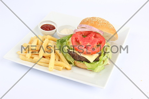 a photo for a hamburger meal including french fries ,tomato and cheese