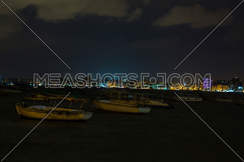 shot for sea shore showing fishing boats at alexandria from day to night