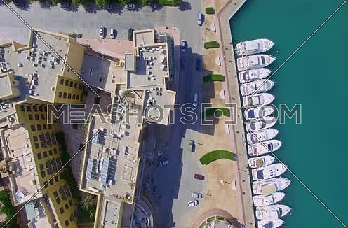 zoom in using  Drone shot flying above Al Gouna Marina  at Day
