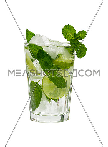Close up one full big glass of mojito cocktail with mint leaves, lime slices and ice cubes, isolated on white background, low angle side view