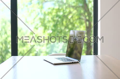 Closeup Of Laptop Set On Table at home