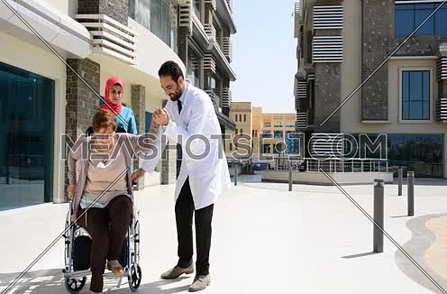 doctor and nurse with elderly person hospital care concept