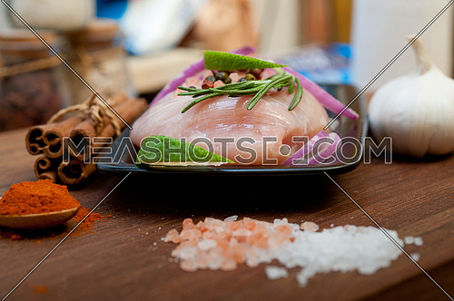 fresh organic chicken breast with herbs and spices
