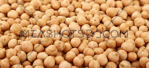 Dried chickpea beans at retail market display, close up pattern background, high angle view