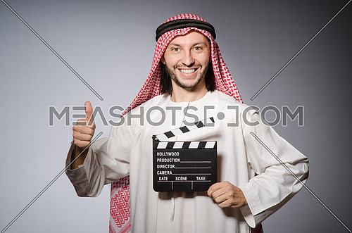 Arab with movie clapper board