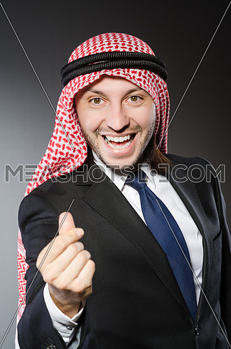 Arab businessman in delight against grey background