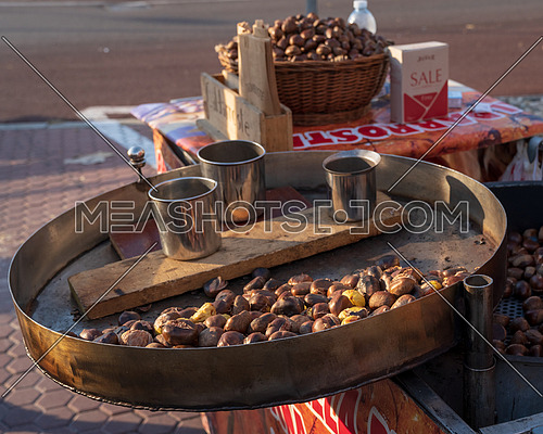 Roast chestnuts cooked over the red-hot grill,