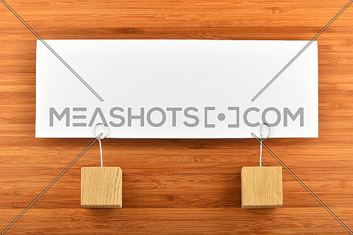Together, one big white paper note with two wooden holders on wooden bamboo background for presentation