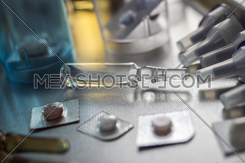 Several vials with different medication in hospital, conceptual image