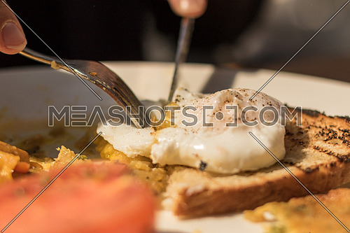 Poached eggs on toast with side salad