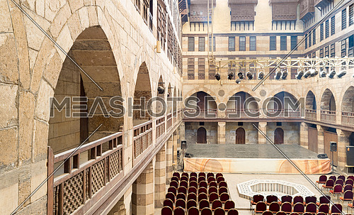Courtyard of caravanserai (Wikala) of al-Ghuri, surrounded by two floors of vaulted arcades leading to storages rooms, and three floors of windows covered by interleaved wooden grids (mashrabiyya), suited in Tablita Street parallel to al-Azhar Street, Medieval Cairo, Egypt