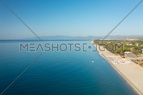 Aerial view of beautiful sea and beach at sunny day, seascape and hill mountain on backgrond, Simeri Mare, Calabria, Southern Italy