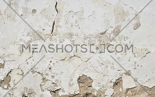 Background texture of old dirty white painted plaster wall with cracks, gaps and grunge stains