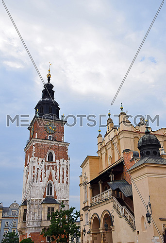 Low angle view of Town Hall tower and Cloth Hall (Sukiennice) at Main Market Square of Krakow, Poland