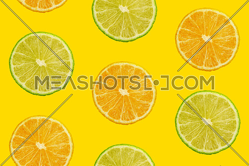 Seamless pattern of fresh ripe orange and lime round cut wedges on yellow teal background