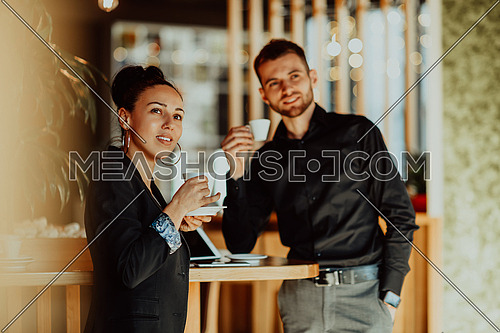 two young people on a break from work in a cafe