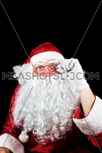 Santa Claus in the Christmas Night Praying Isolated On Black Background
