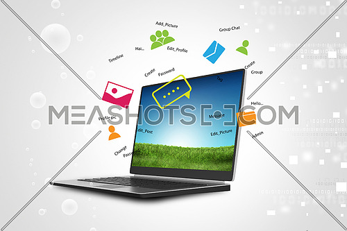 Laptop on green grass in color background
