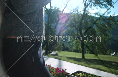 young woman using tablet computer standing on terrace