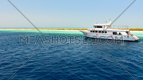 In the picture a yacht anchored near the port of Hamata , Egypt Red Sea