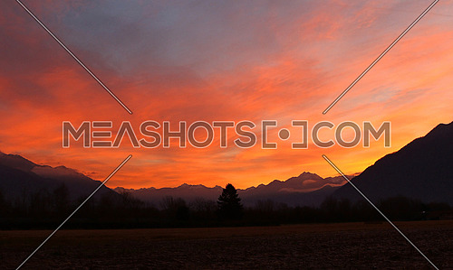Colorful winter sunrise over the Swiss Alps in Ticino