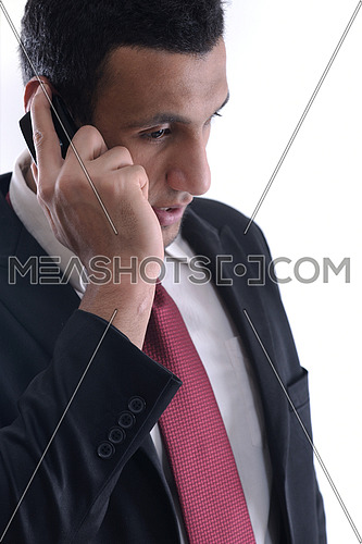 Portrait of a business man talk with cell mobile  phone isolated on white background. Studio shot communication concept