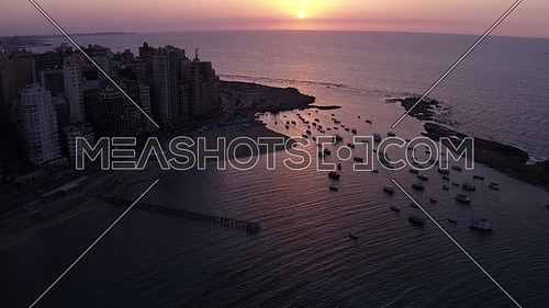 Aerial shot for Light House in Alexadria City ,  Egypt at dusk