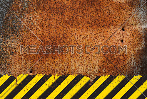 Grunge rusty corroded metal background with yellow and black painted grunge hazard sign stripes and copy space