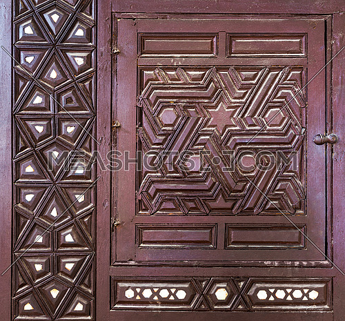 Single arabesque sash of an old ottoman era style built-in cupboard with geometrical engraved decorations inlaid with ivory, Rosetta City, Egypt