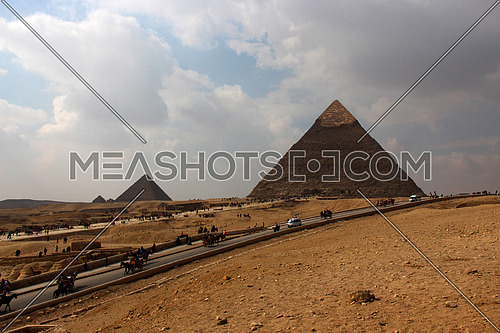 a photo showing the  pyramids build in Giza during the pharaohs ancient civilization and the architecture style