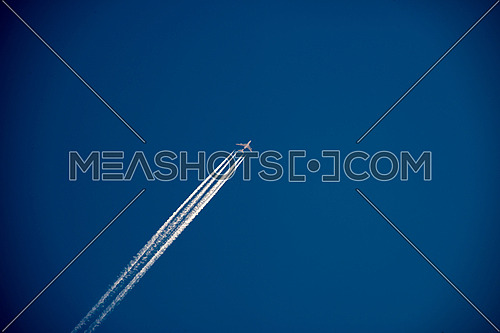 A380 4 engine jetliner at cruise altitude with contrails