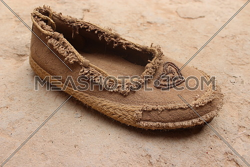 close up for an old Amazigh brown shoe.