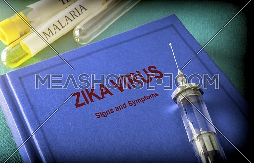 Vintage Syringe On A Book Of Zica Virus, Medical Concept