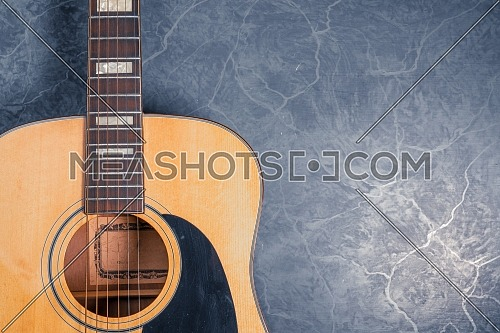 acoustic guitar on blue marble background,music concept.