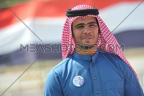 A young Egyptian from Sinai Bedouins marks the presidential candidate Abdul Fattah al-Sisi on the chest outside the polling center on the last day of the Egyptian presidential elections in the city of Dahab in the province of South Sinai