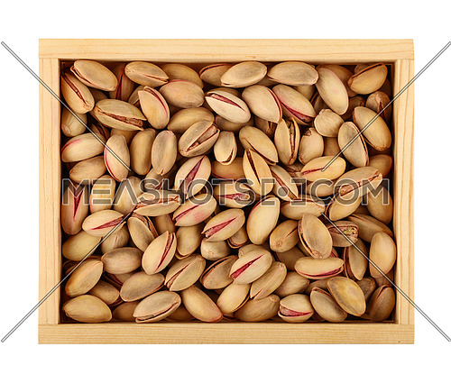 Close up fresh roasted pistachio nuts in wooden box isolated on white background, elevated, high angle top view, directly above