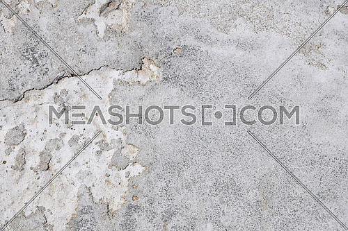 Damage fault crack in grunge concrete wall or floor with stains background