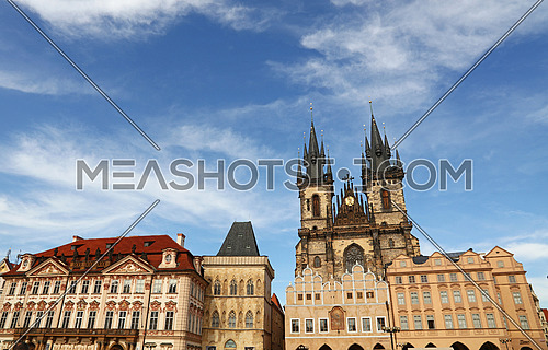 Low angle view of historical Old Town Square and Cathedral of Our Lady before Tyn over clear blue sky, Prague, Czech Republic