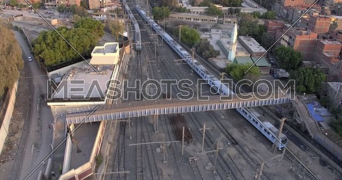 Aerial shot for Railway Station while Metro Passing by in Cairo at day