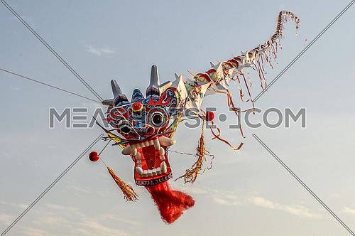 dragon shaped kite flying in the sky