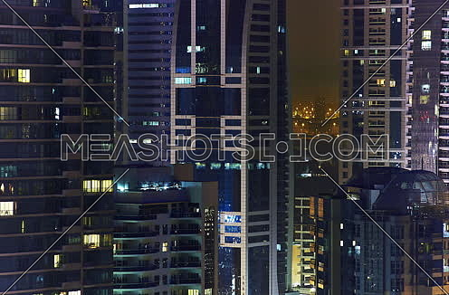 timelapse towers in dubai marina at night