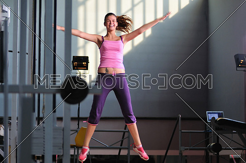 one young happy  woman jump indoor in fitness club