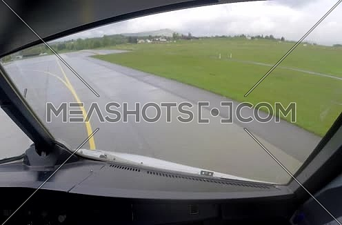 inside cockpit shot for plane moving on runway at  Airport at rainy day