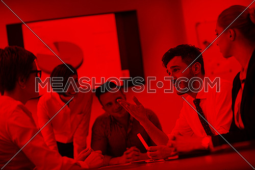startup business, young creative  people group brainstorming on meeting at office, using laptop and tablet computer to note ideas plans and projects