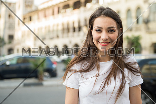Portrait of a beautiful young lady in the street